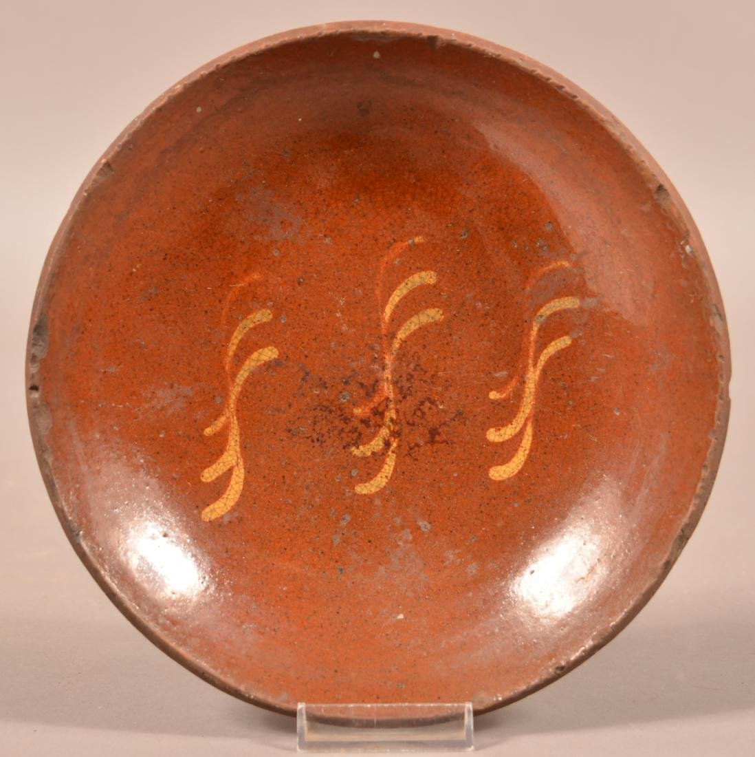 Redware Yellow Slip Decorated Plate.