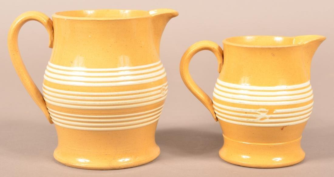 Two Matching Antique Yellowware Pitchers.