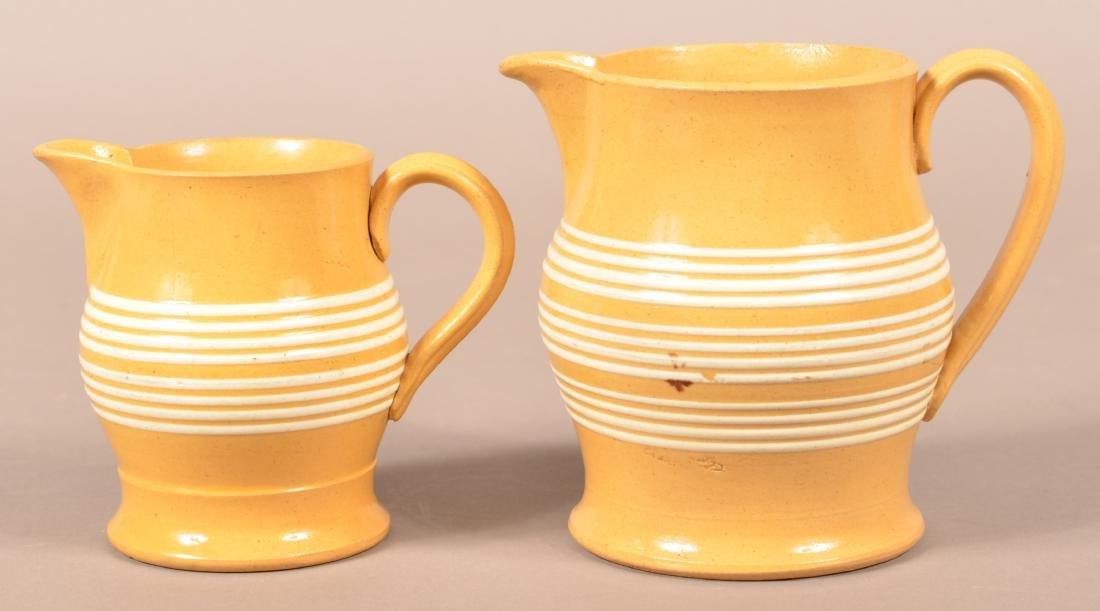 Two Matching Antique Yellowware Pitchers. - 2