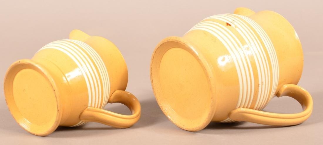Two Matching Antique Yellowware Pitchers. - 3
