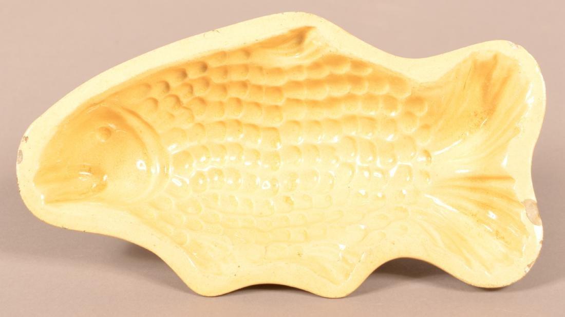 Large Yellowware Fish Form Mold.