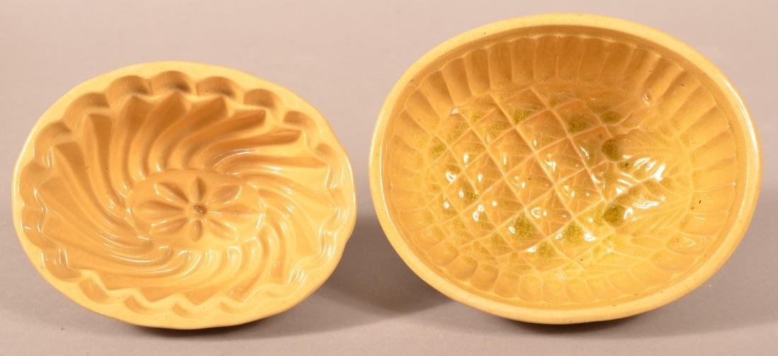 2 Antique Yellowware Oval Molds.