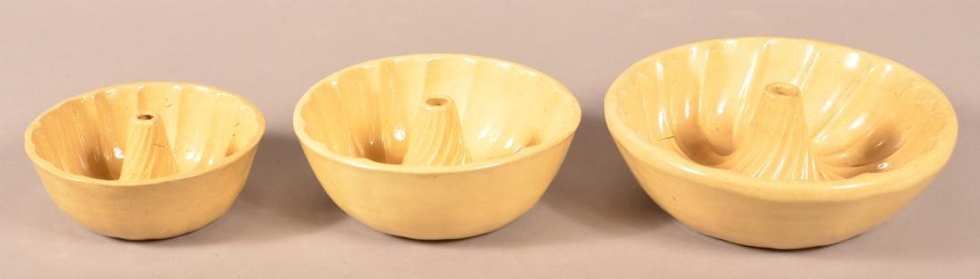 Set of Three Yellowware Turk's Head Molds.