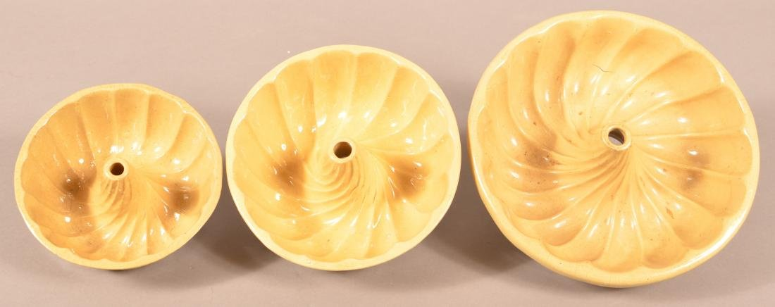 Set of Three Yellowware Turk's Head Molds. - 2
