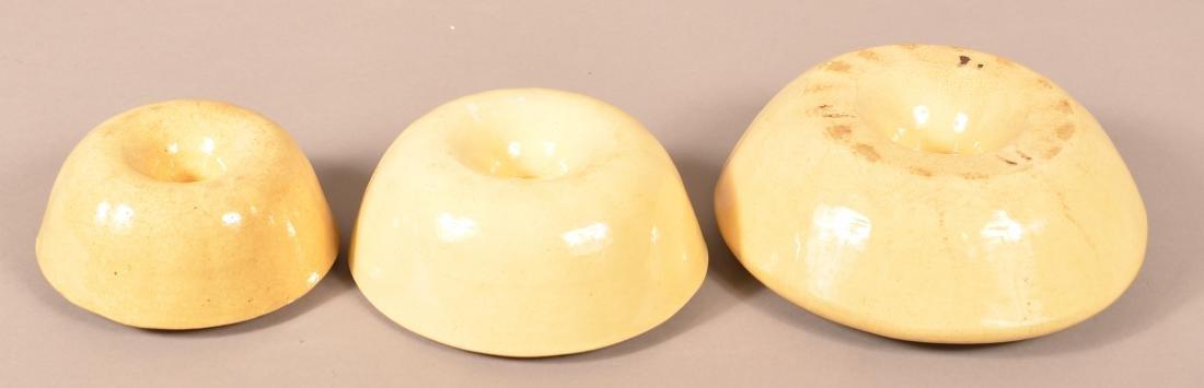 Set of Three Yellowware Turk's Head Molds. - 3