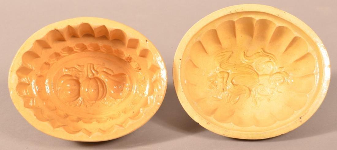 2 Antique Yellowware Oval Molds.