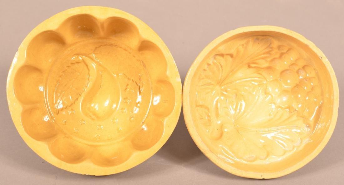2 Antique Yellowware Round Molds.