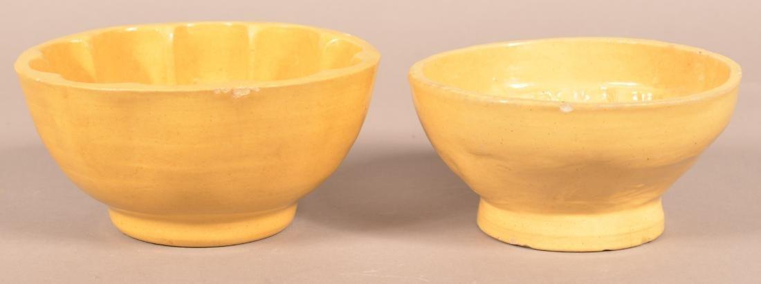 2 Antique Yellowware Round Molds. - 2