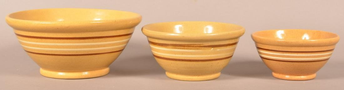 Three Antique Yellowware Graduated Bowls.