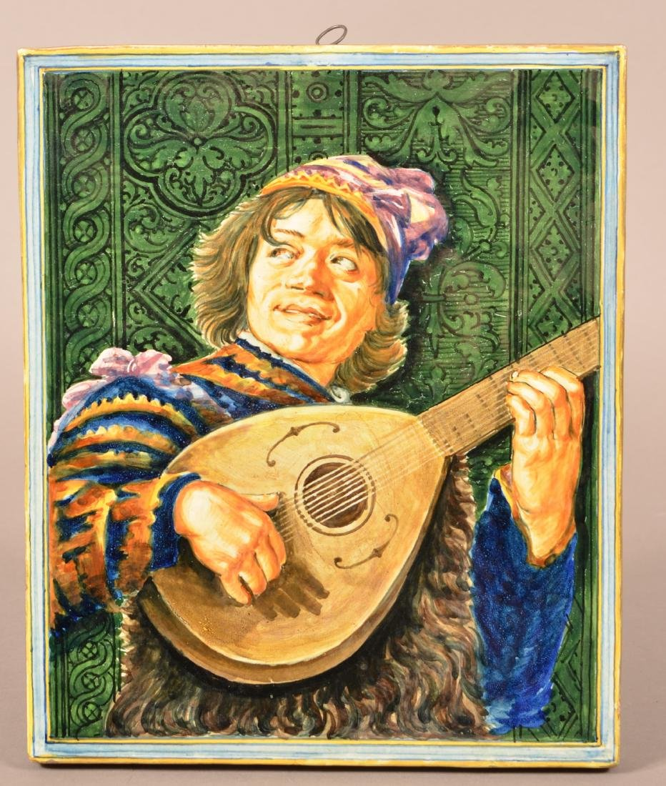Pottery Wall Plaque Depicting a Jester with Lute.