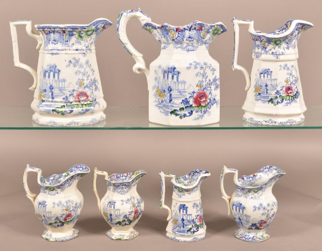 7 Cleopatra Pattern Ironstone China Pitchers.