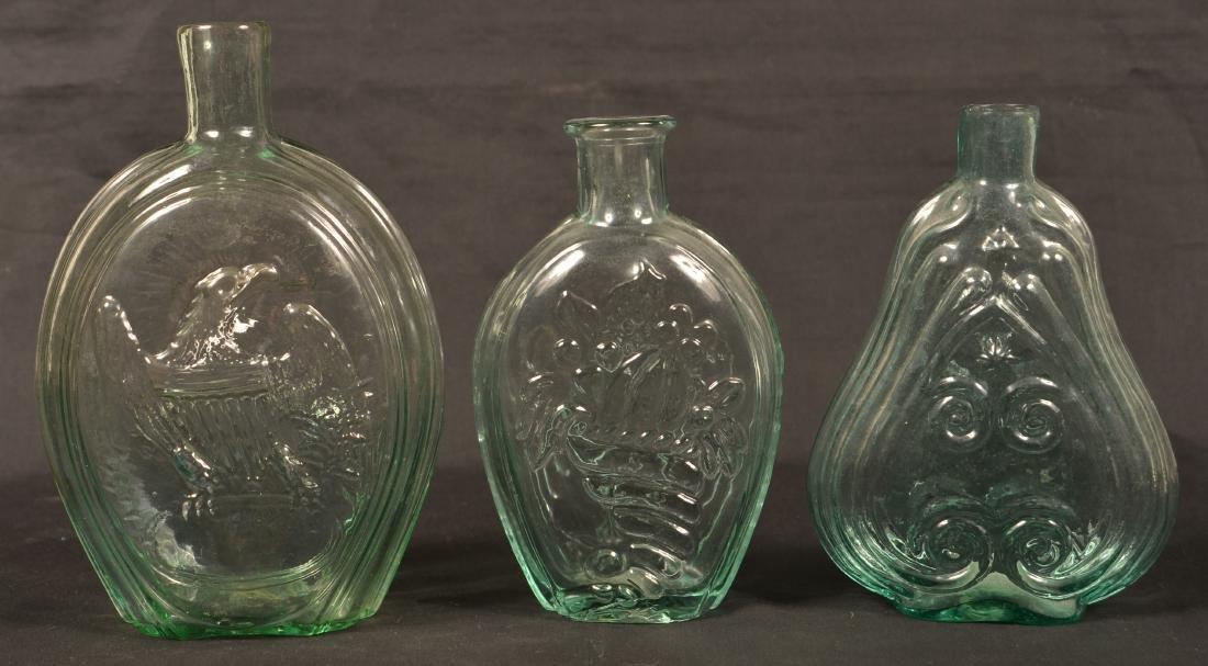 Three Various Aqua Flasks.