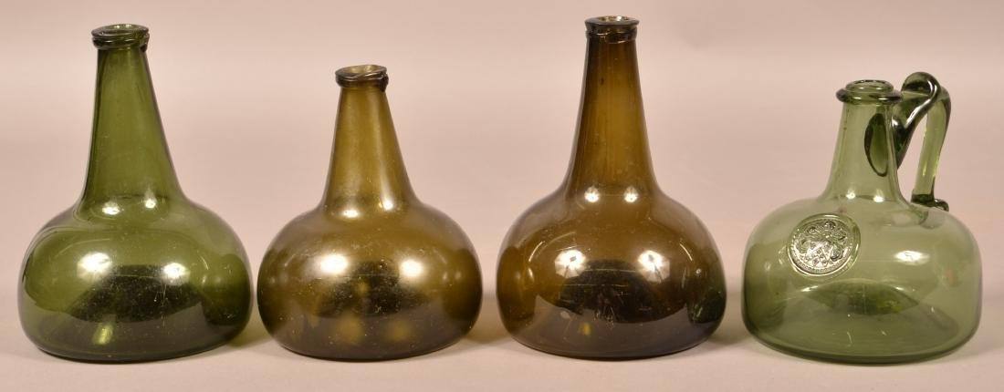 Four Various Emerald Green Squat Form Bottles.