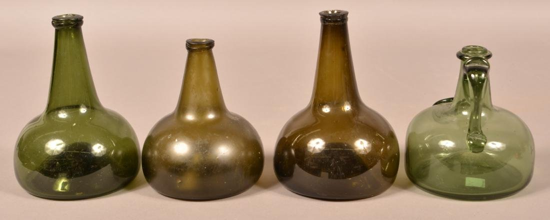 Four Various Emerald Green Squat Form Bottles. - 2