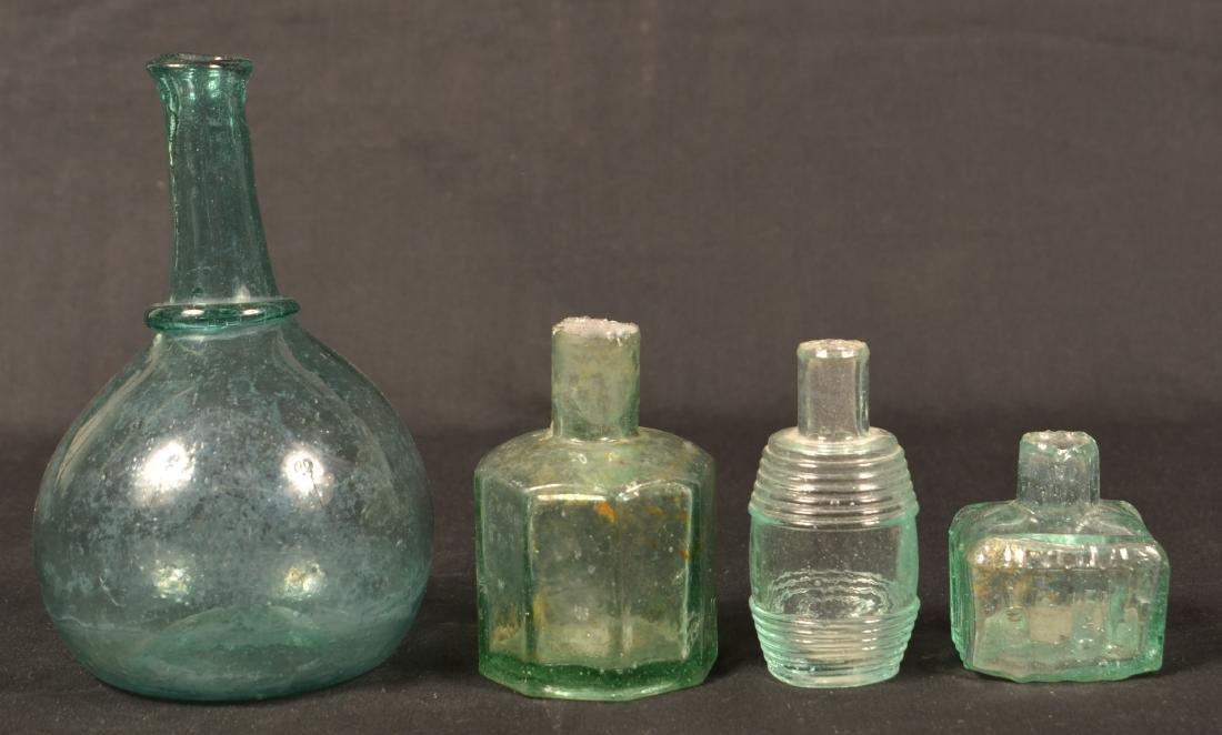 Four Various Blown Glass Bottles.
