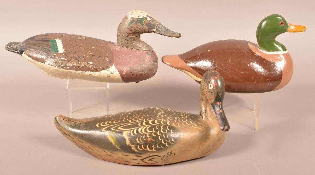 Three Unsigned Carved Duck Decoys.