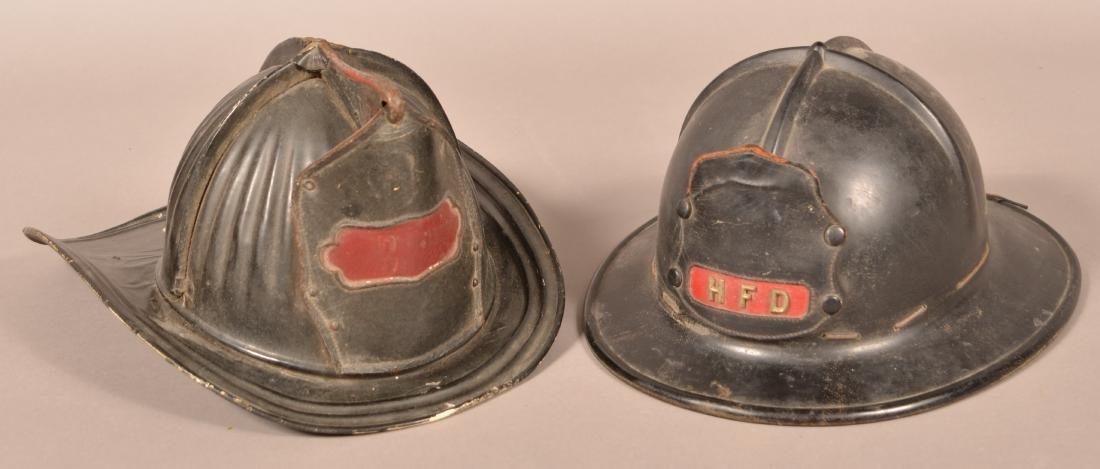 Two Vintage Fireman's Helmets.