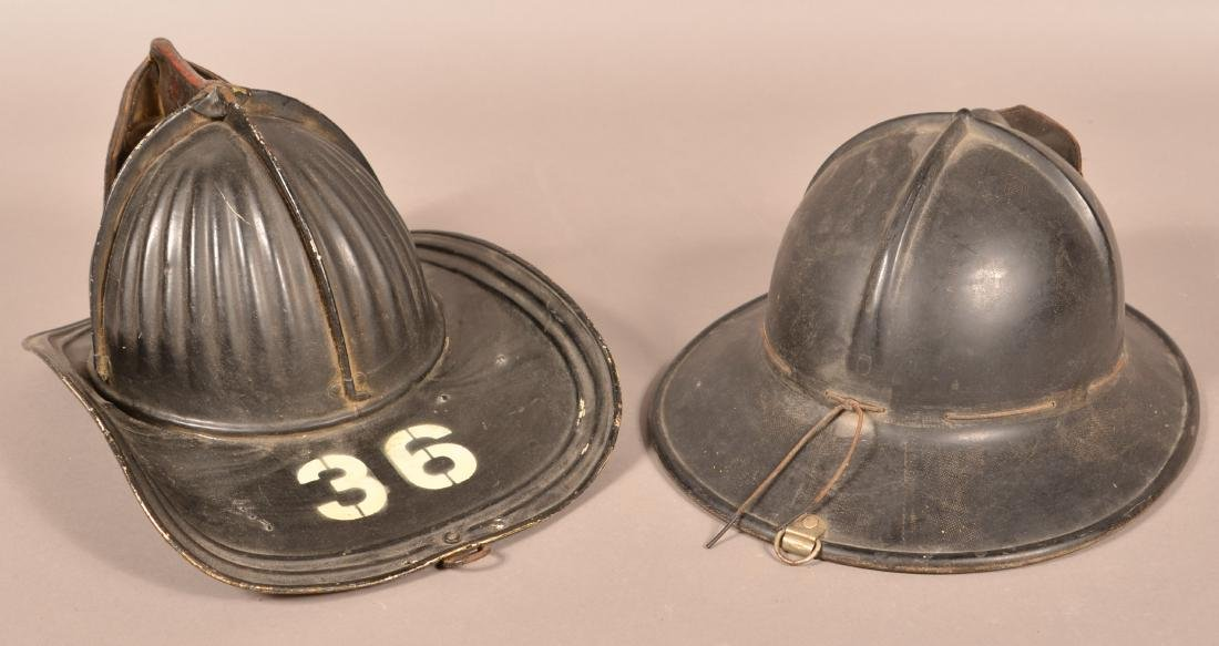 Two Vintage Fireman's Helmets. - 2