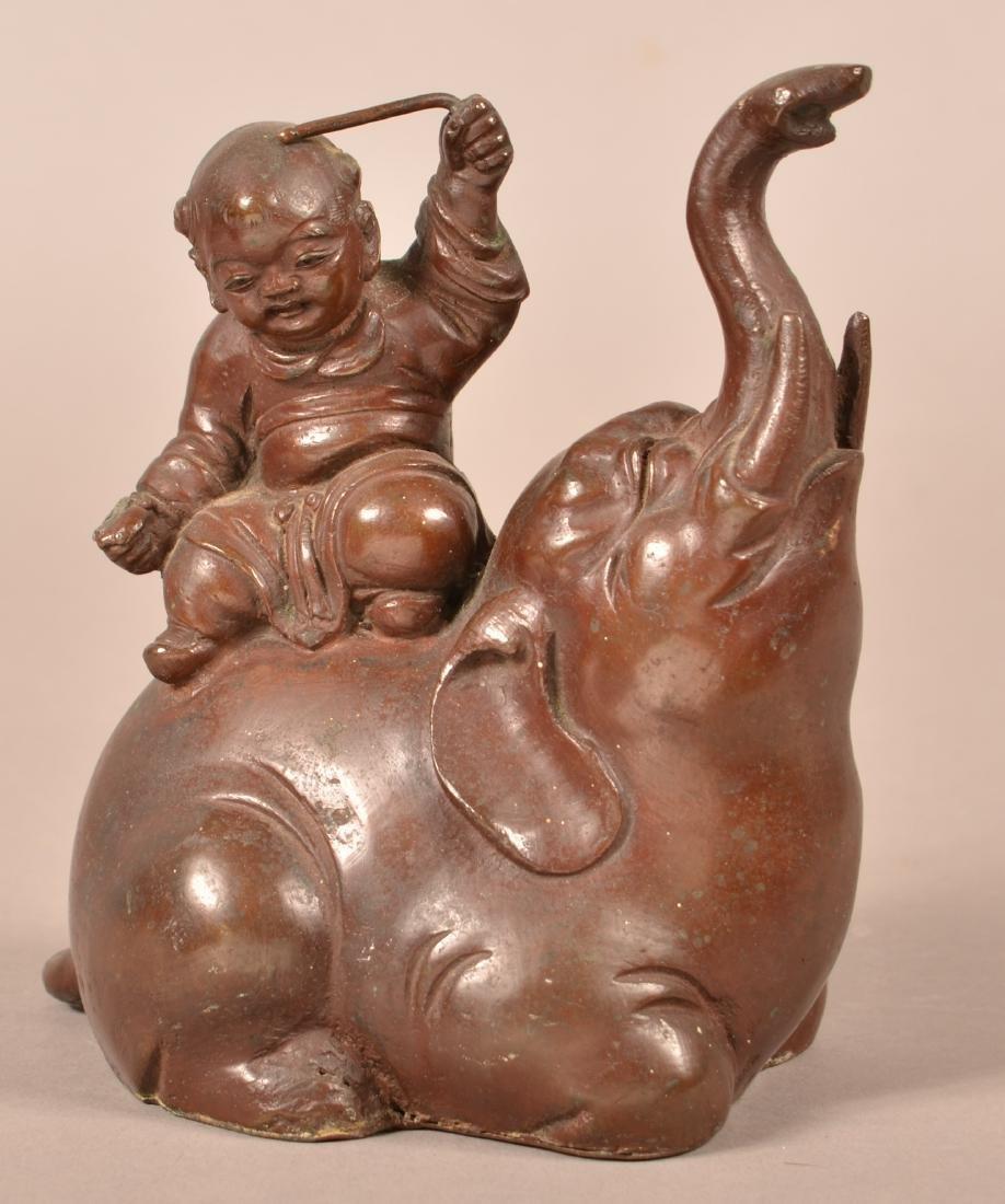 Japanese Bronze of a Boy Seated on an Elephant.