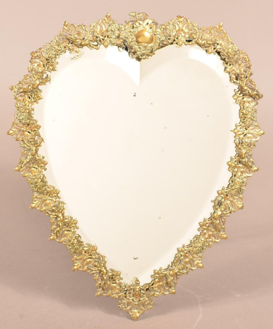 Antique Ornate Brass Heart Shaped Mirror.