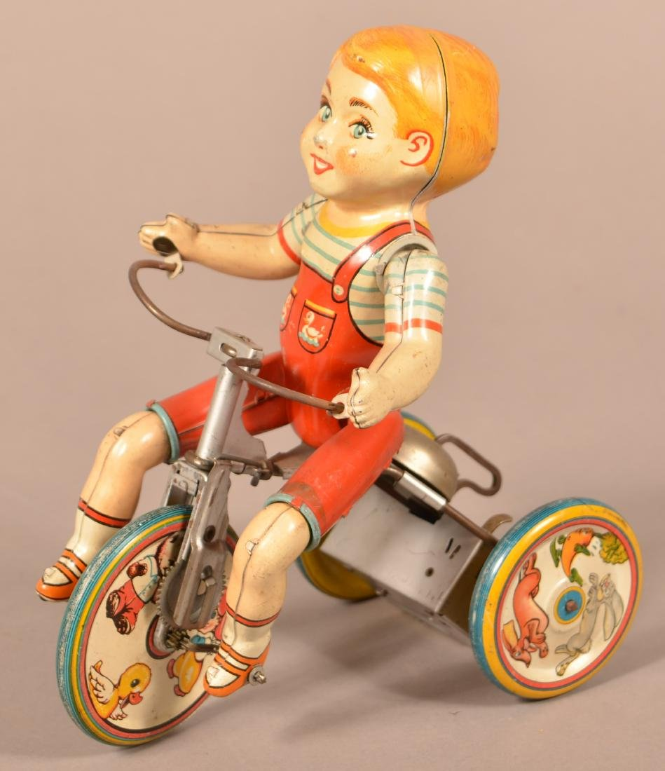 """Unique Art """"Kitty Cyclist"""" Tin Lithograph Wind-up Toy."""
