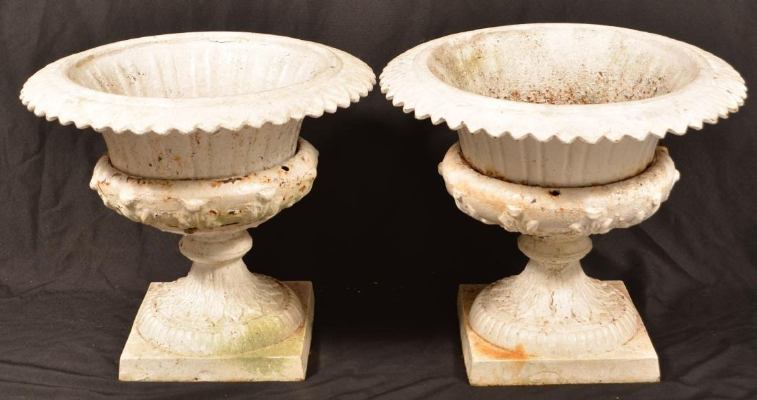 Pair of Victorian Cast Iron Urn Form Planters.