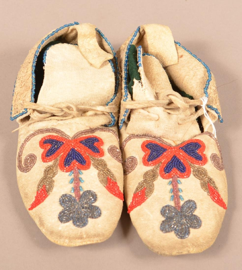 Pair of Floral Beaded, Rawhide Soled Moccasins