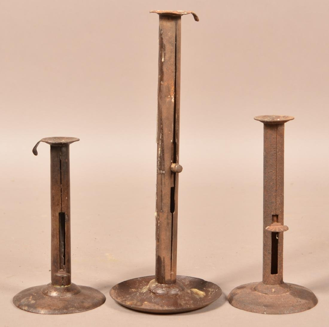 "Three Antique Iron Hog Scraper Candlesticks. 7"" to"