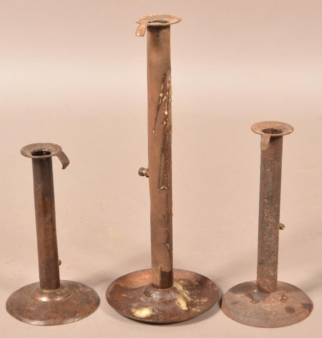 "Three Antique Iron Hog Scraper Candlesticks. 7"" to - 2"