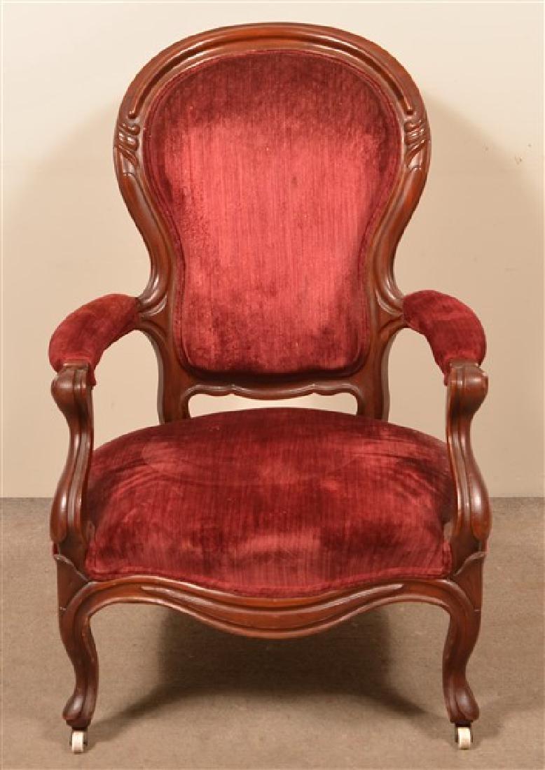 Victorian Walnut Finger Carved Gentleman's Chair.