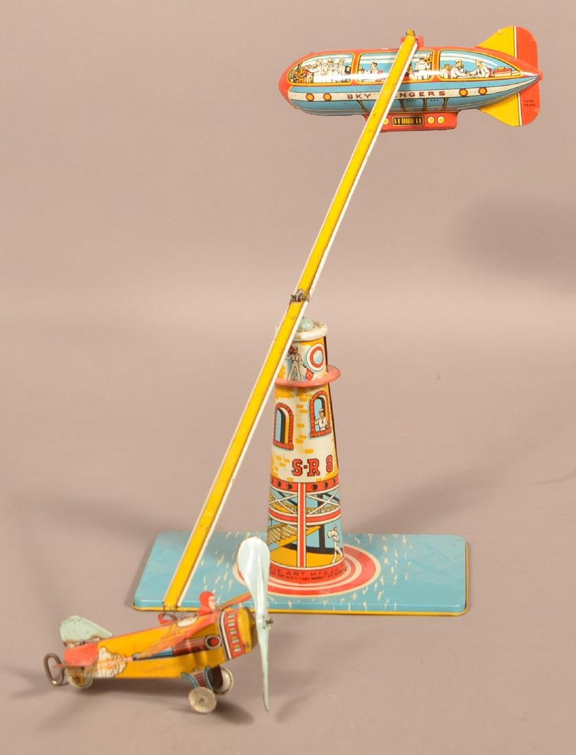 Unique Art Sky Ranger Tin Lithograph Wind-up Toy.