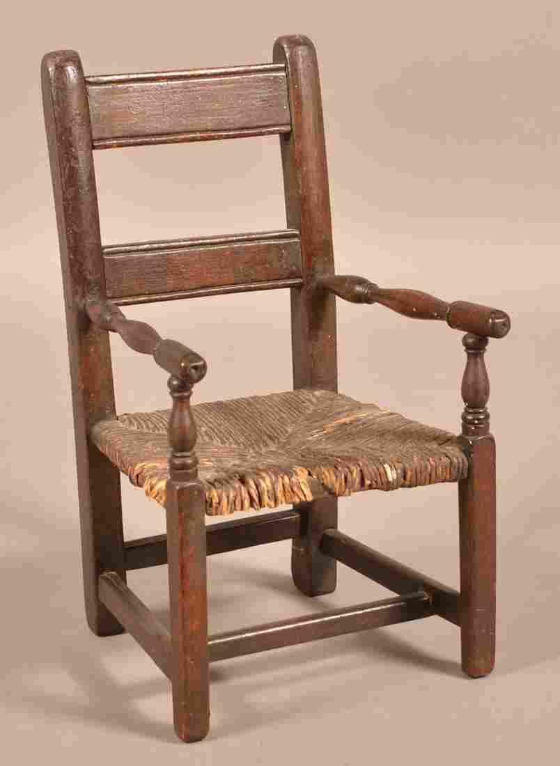 Miniature 18th Century Walnut Rush Seat Armchair.