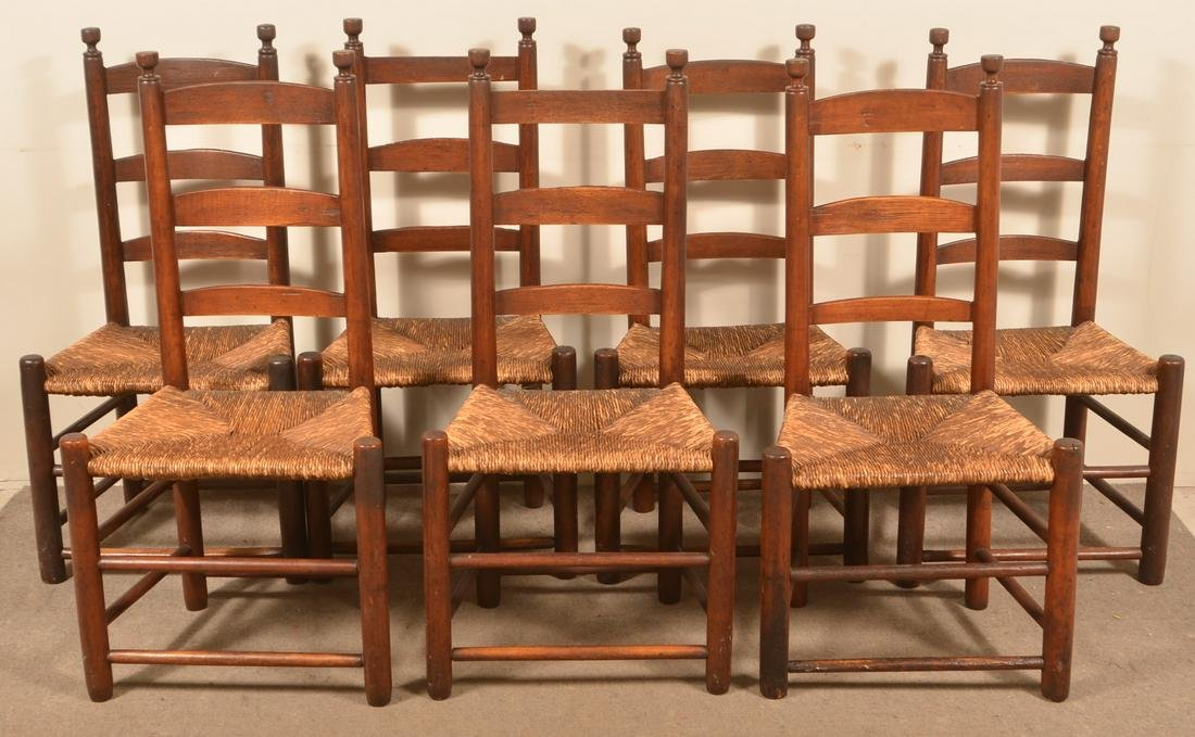 Set of Seven Rush Seat Ladder-back Sidechairs.