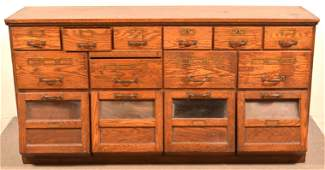 Late 19th Century Oak Country Store Seed Cabinet.