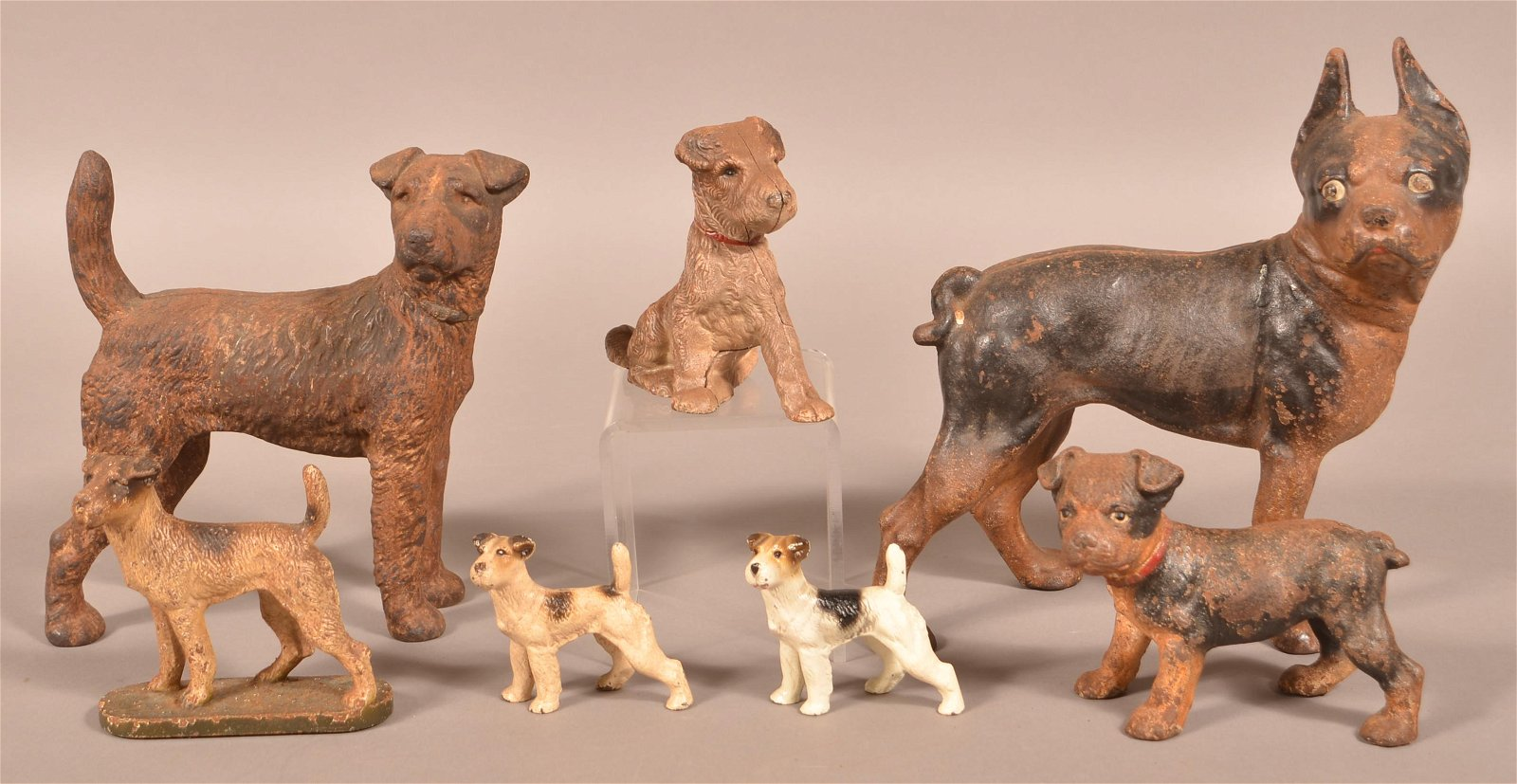 Seven Various Hubley Cast Iron Dogs.