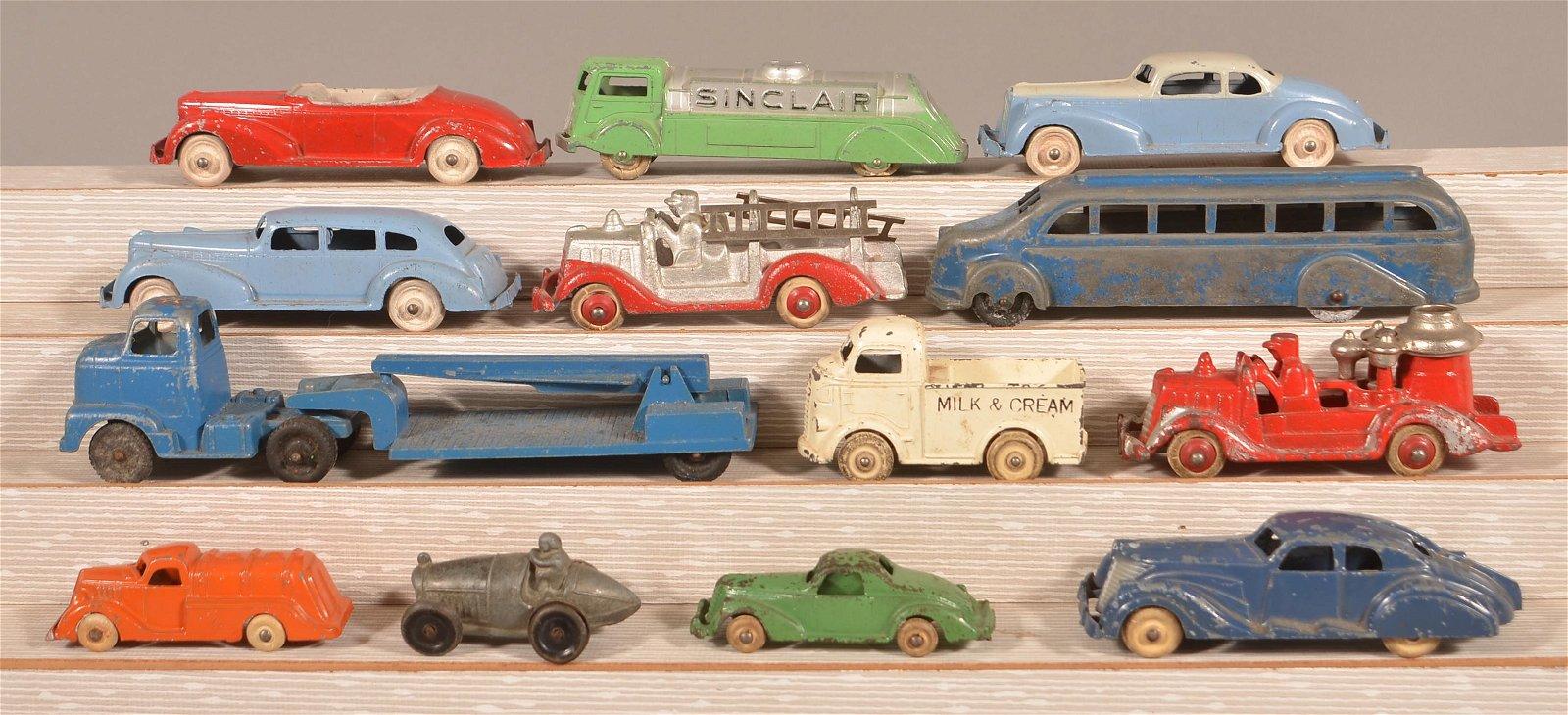 Lot of 13 Vintage Cast Metal Vehicles.