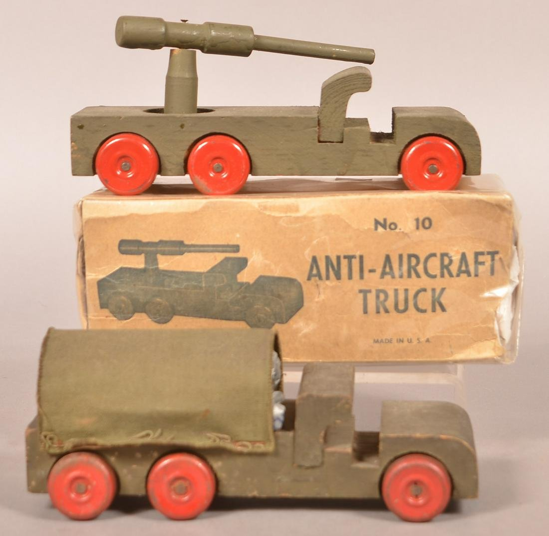 Two U.S.A. Vintage Wood Army Vehicles.