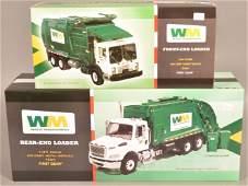 Two First Gear Waste Management Trucks.