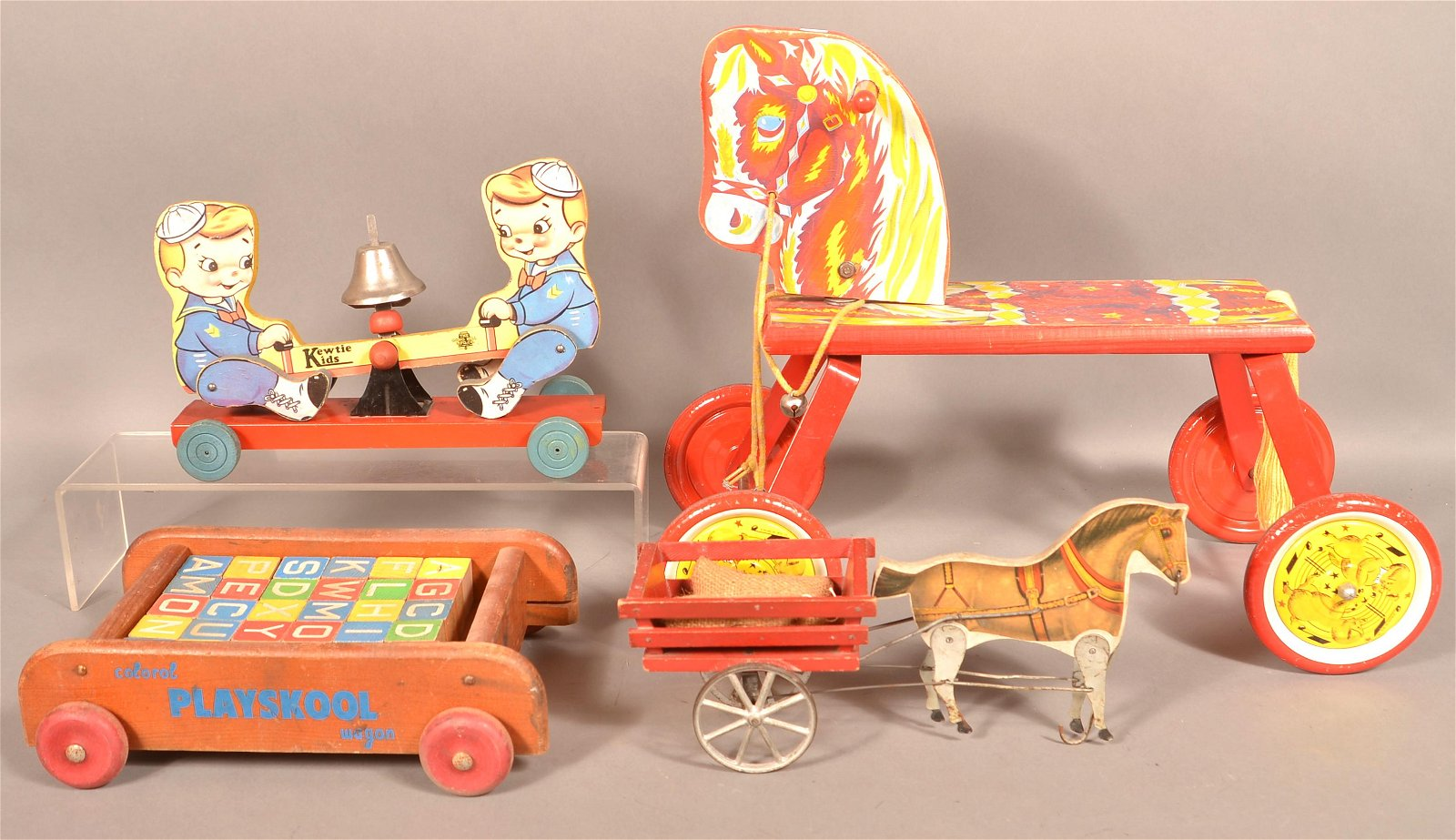 Four Vintage Wood and Litho Paper Child's Pull Toys.