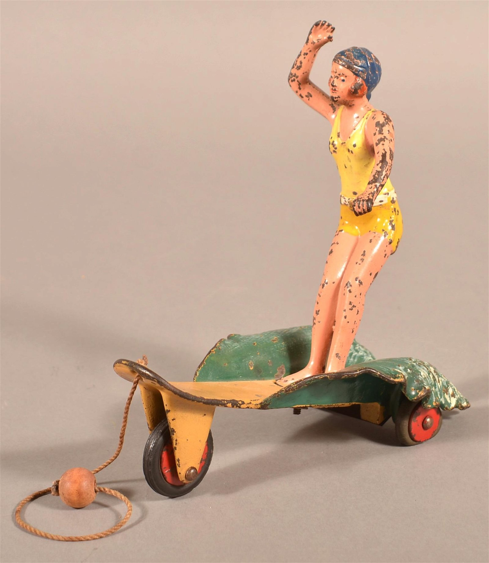 Scarce Hubley Cast Iron Surfer Girl Pull Toy.