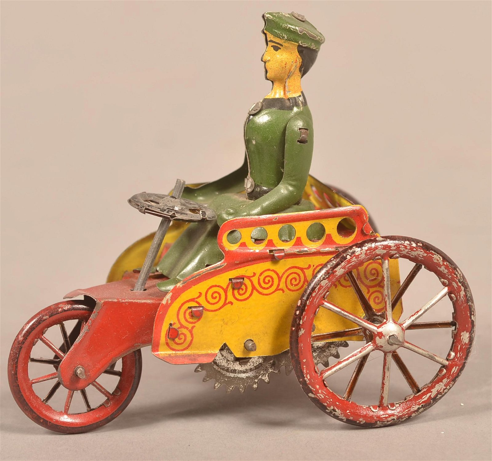 German Tin Litho Wind-Up Three Wheel Vehicle.