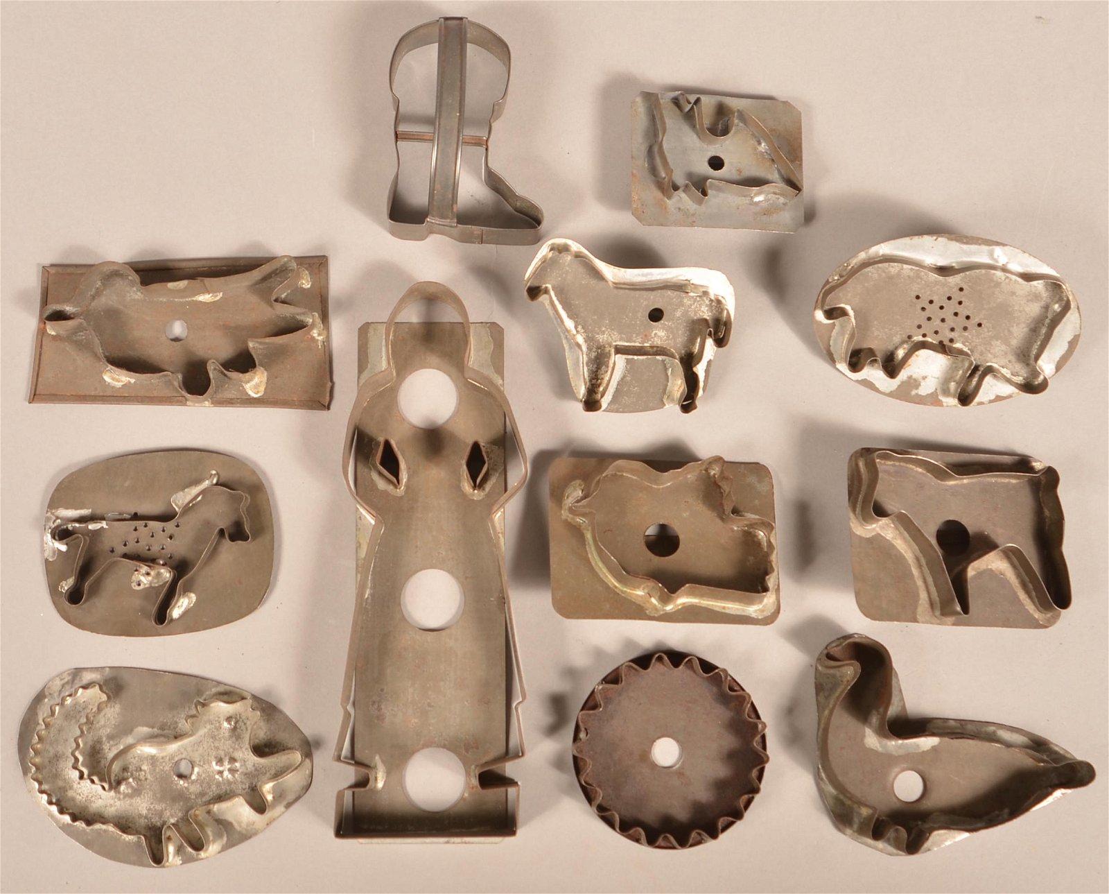 Twelve Various Antique Figural Tin Cookie Cutters.
