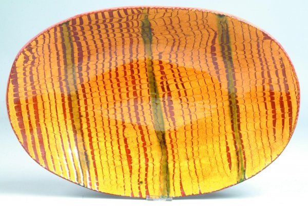 23: Breininger Pottery Slip Decorated Charger, oval for
