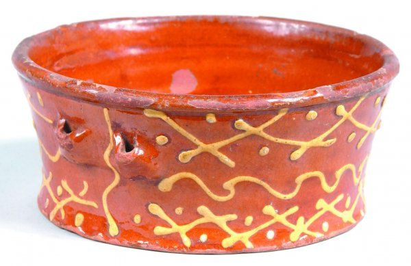 451: Slip Decorated Redware Bowl, round form with handl