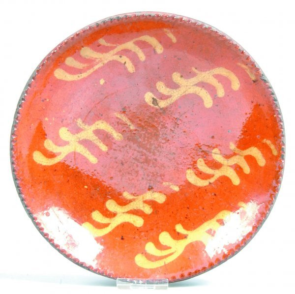 454: Slip Decorated Redware Plate, round form with cogg