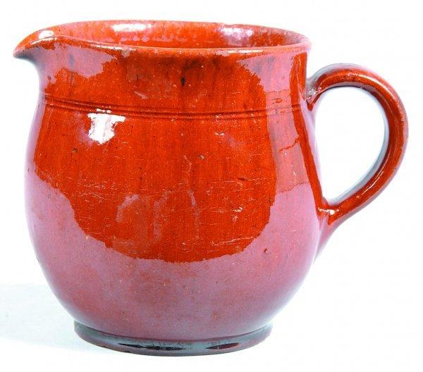 465: Redware Bulbous Pitcher, pour spout rim, applied C