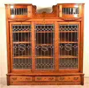 Antique American Oak Leaded Glass Triple Bookcase.