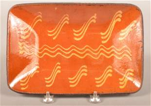 PA 19th Century Slip Decorated Redware Loaf Dish.