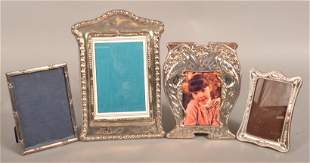 Four Sterling Picture Frames.
