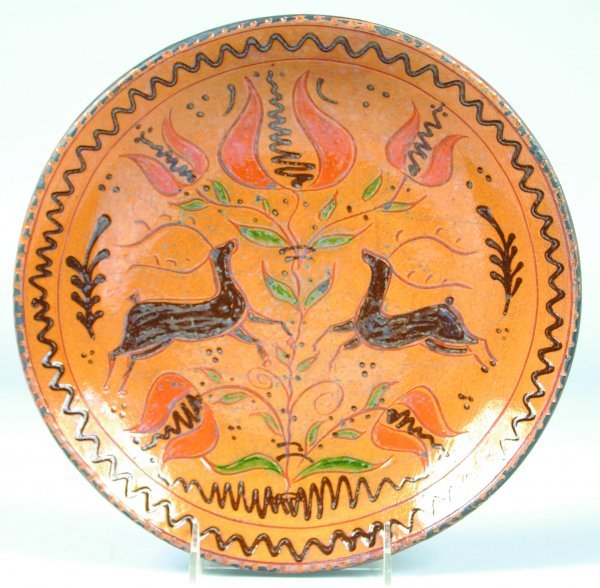 14: Greg Shooner 2002 Redware Plate having central tuli